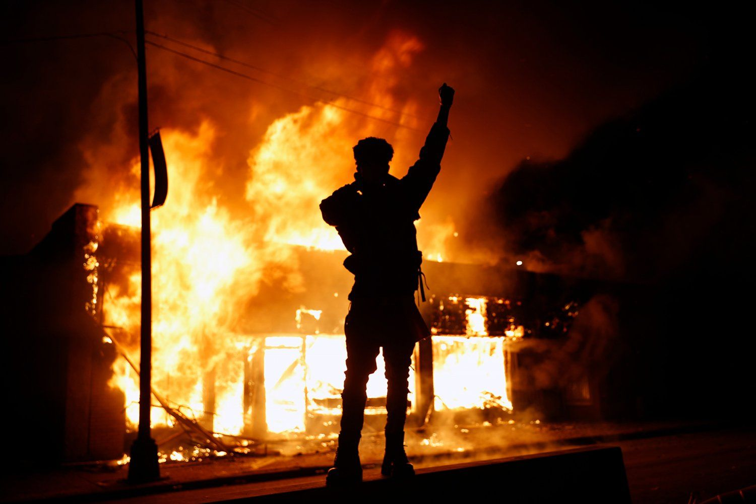 A check-cashing business burns during protests in Minneapolis on Friday.jpg