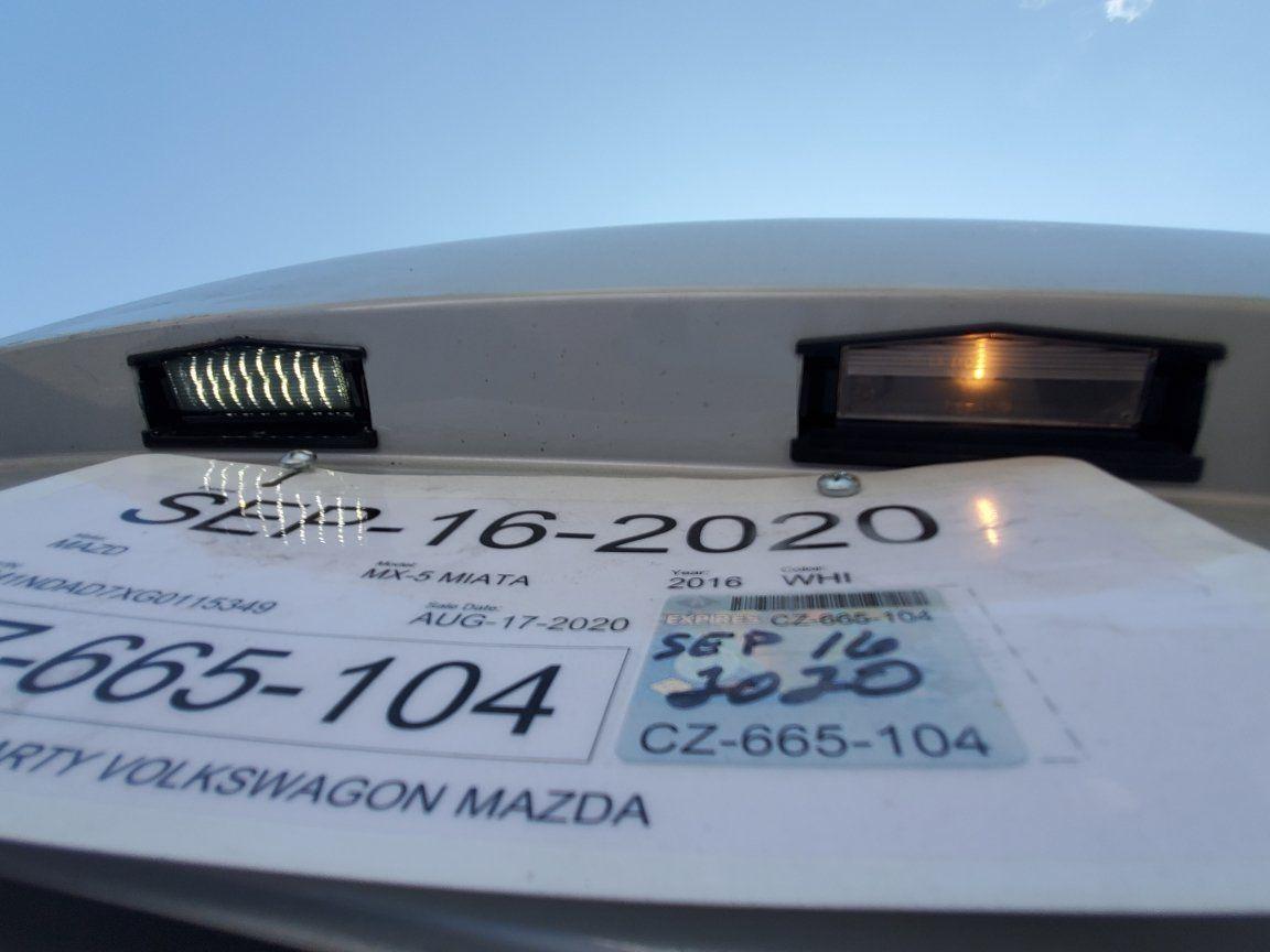 Ghost - CarbonMiata Smoked LED License Plate Light vs OEM Lit.jpeg